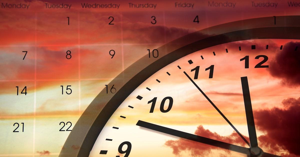 Clock face and calendar in sky